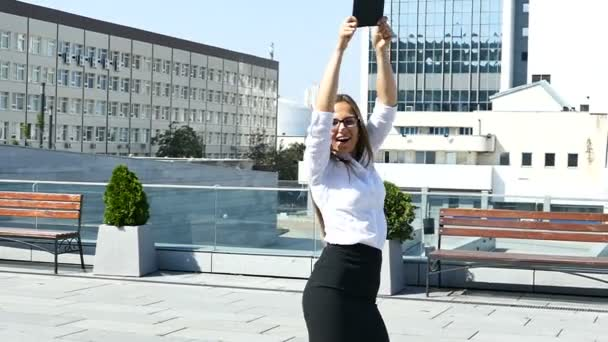 Office rest time. Long-hair  business woman  in office area dance with folder. Slow motion
