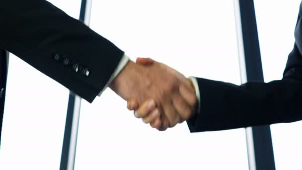 4K.Two business partner, man and woman, shake hands when meeting.