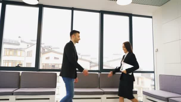 4K. Office  meeting. Two business partner, man and woman, shake hands  and go away