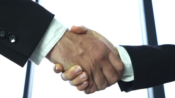 Business partner, man and woman, shake hands close up when meeting. Slow motion