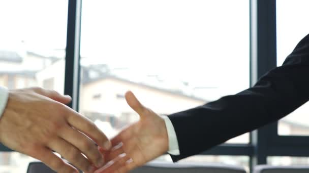Man and woman, shake hands when meeting in office. Slow motion
