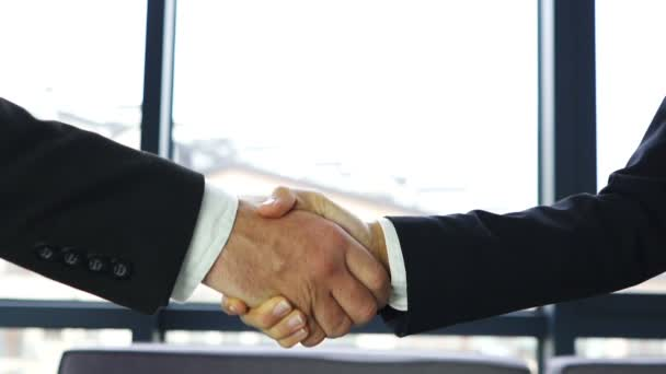 Man and woman, shake hands close up when meeting in office. Slow motion