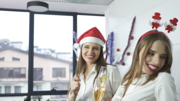 Happy business ladies in office with champagne celebrate Christmas .Slow motion