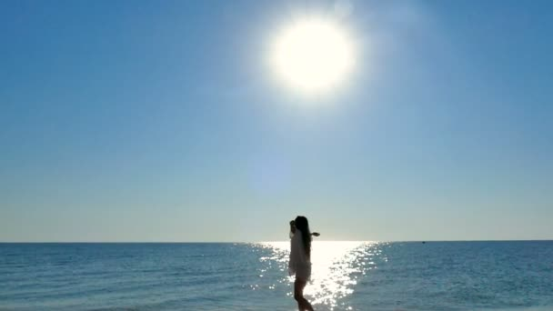 Girl  teenager turn, dance and against sea, ocean, sunset or sunrise. Slow motion