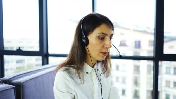 4K.Office call center  work. Woman operator answer client, using laptop