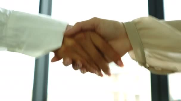 4K.Two business partner woman, shake hands when meeting. Close up