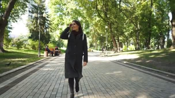 4k. Pretty smiling  young Asian woman walk in city park. Enjoy life Steady shot
