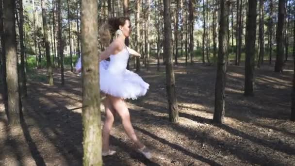 Skill woman ballerina in white tutu dancing in forest area, slow motion. Free dancer improvisation  ballet team