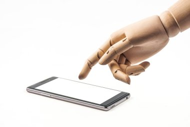 hand of wood doll make fingers to touch with smart phone on whit