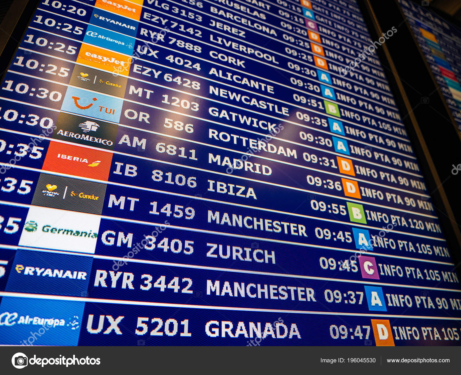 Airport information board close-up in modern Spanish Europe Airp — Stock  Photo