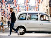 Londýn, Velká Británie - 18. května 2018: Union Jack vlajky na Regent Street den před královskou svatbu. Královská svatba mezi princ Harry a Meghan Markle se bude konat na zámku Windsor v Berkshire na 19. května 2018