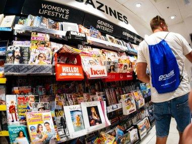 man shopping for new newspaper in London Press Kiosk