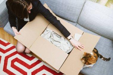 Business woman unpacking unboxing cardboard box box