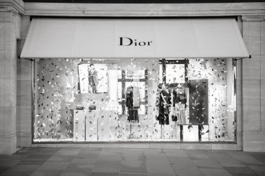 LONDON, UNITED KINGDOM - MAY 18, 2018: Congratulation message from Christian Dior fashion boutique to  HRH Prince Harry of Wales KCVO and Ms Meghan Markle flagship store on Regent street for Royal Wedding black and white
