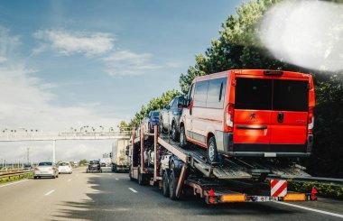 MUNCHEN, GERMANY - OCT 7, 2018: Large truck carrying new peugeot vans and cars on german highway autobahn vehicle logistics, vehicle retailer, transport fleets, fleet transportation