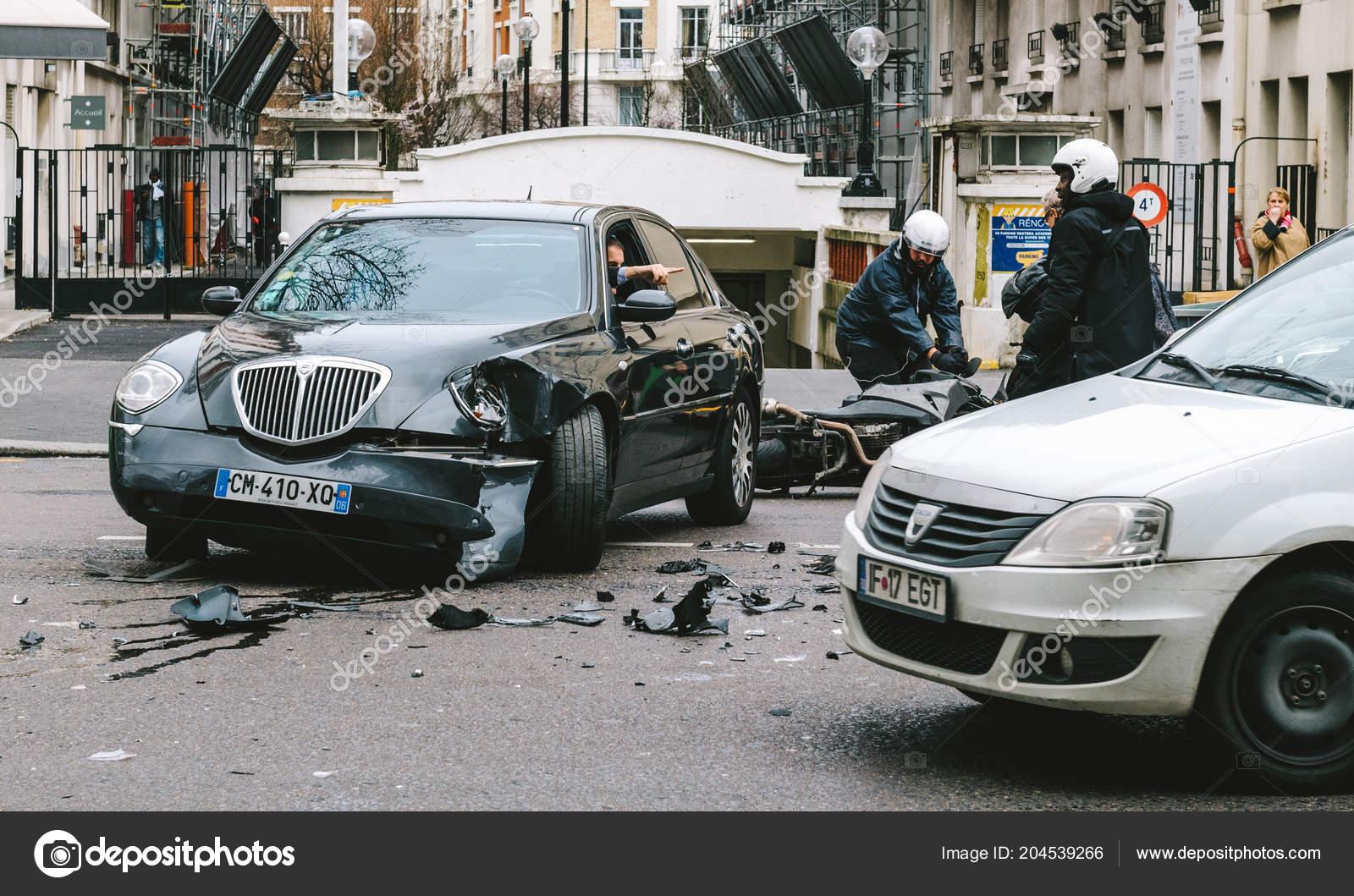 Car Accident On Paris Street Between Luxury Limousine Lancia Th