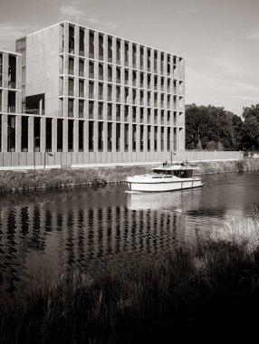 STRASBOURG, FRANCE - JUNE 26, 2018: Luxury yacht in front of Turkish embassy in Strasbourg construction site on Quai Jacoutot Ill River during summer - black and white