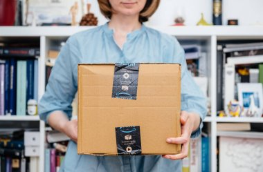 Woman holding presentation of Amazon Prime package beautiful