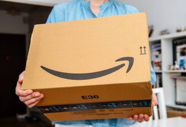 Woman holding presentation of Amazon Prime package