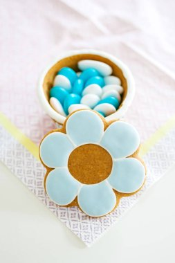 Baptism Christening sweets gift for guests on delicate napkin with open lid made from dough and marzipan paste containing multiple sweets