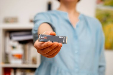 PARIS, FRANCE - AUG 2, 2018: Woman hands holding new Samsung 870 Pro NVME PCIE SSD hard drive disk with high read and write speed Samsung 870 Pro