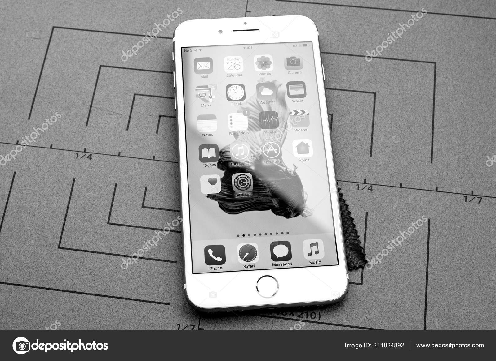 Paris france sep 26 2016 new apple iphone 7 8 plus smartphone after unboxing with home screen and multiple apps black and white photo by