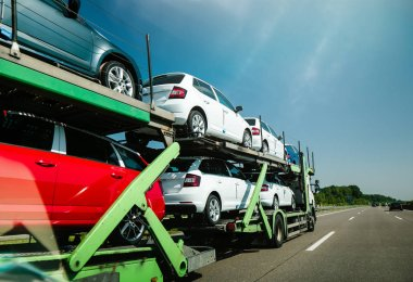 Riding truck with new cars delivery new cars autobahn