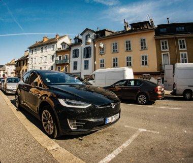 Tesla Model X SUV car parked street wide angel lens