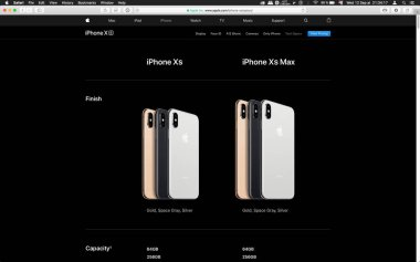London, United Kingdom - September 12, 2018: Comparing golden Apple iPhone XS iPhone XS Max iPhone X R smartphone computer, seen on computer MacBook display after Cupertino keynote product launch