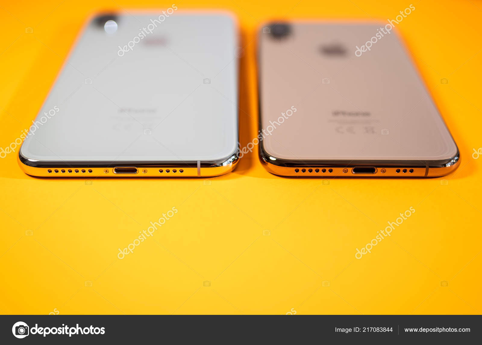 Rear View Of Apple Iphone Xs Max Orange Background Stock