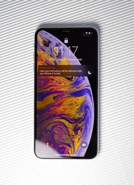 New iPhone XSsmartphone lock screen white background