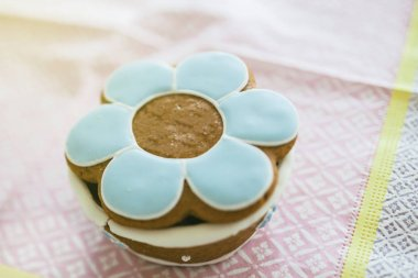 Baptism christening sweets on delicate napkin with closed lid made from dough and marzipan paste containing multiple sweets