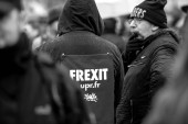 man with frexit sign poster on his jacket at protest in France