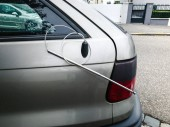 Fotografie Broken radio antenna on car