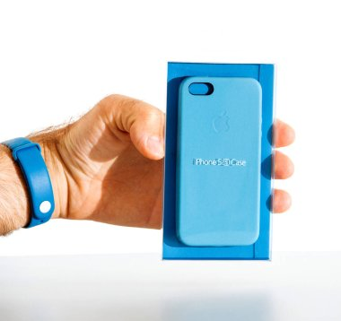 man holding Apple iphone blue leather case