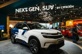PARIS, FRANCE - OCT 4, 2018: Customers curious people admiring new electric plug in Citroen SUV c5 Aircross hybrid at International car exhibition Mondial Paris Motor Show side view of the car