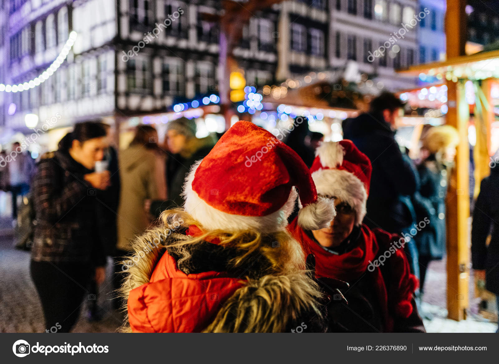 Two adult women wearing funny Christmas Hats – Stock Editorial Photo ... b43e56a62f
