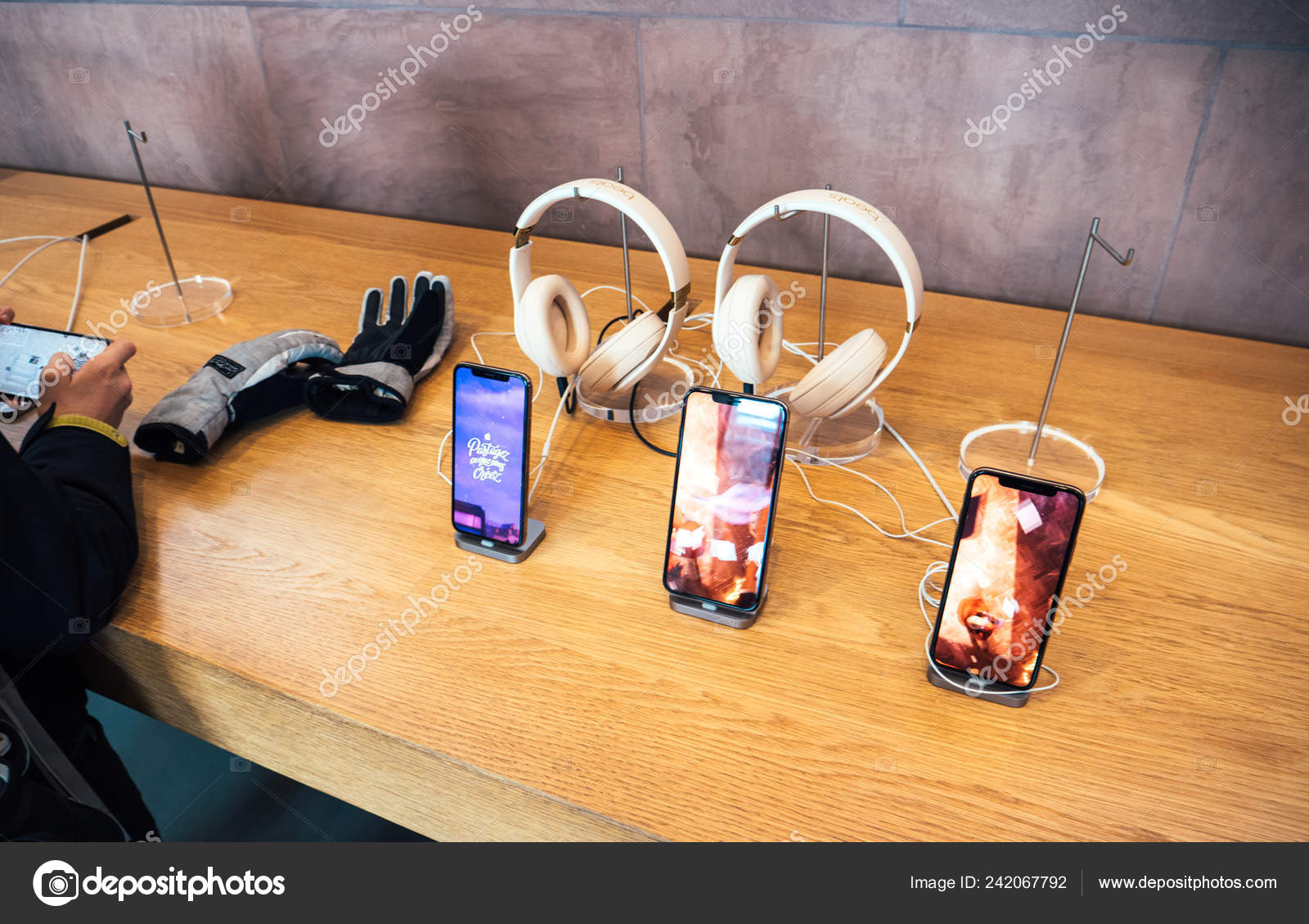 8060d724ff0 Apple Computers iPhone XS testing in Apple Store headphones Beats by Dr Dre–  Stock Editorial Photography