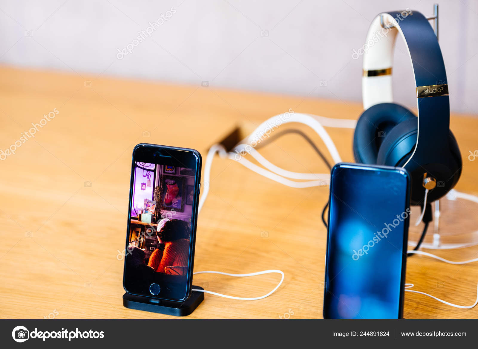 41547a1d9c1 Apple Computers iPhone XS next to iPhone 8 Beats Studio 3 headphones– Stock  Editorial Photography
