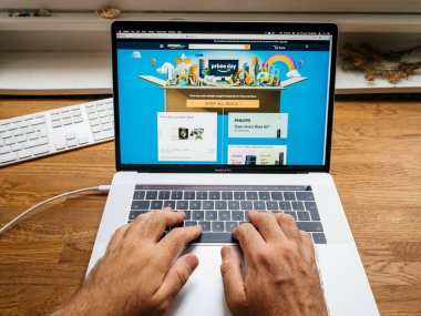 Amazon Prime day man shopping on computer for diverse goods