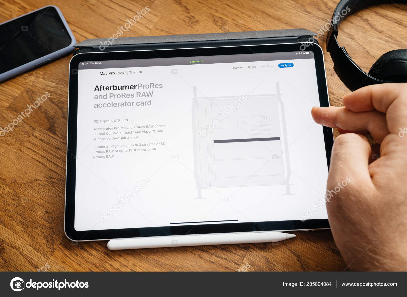 Man reading on iPad Pro launch Mac Pro workstation