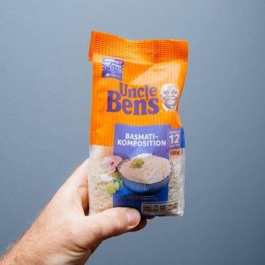 Man hand holding Uncle Bens basmati rice