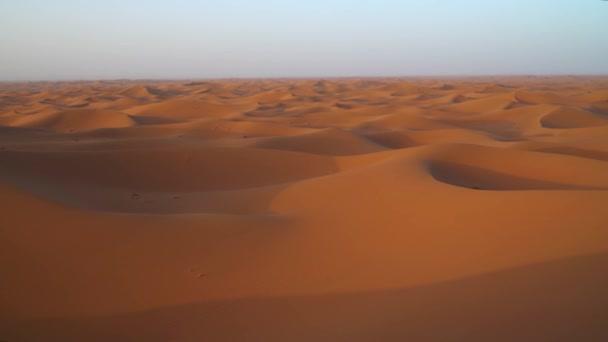 Aerial view on big sand dunes in Sahara desert at sunrise, Africa, 4k