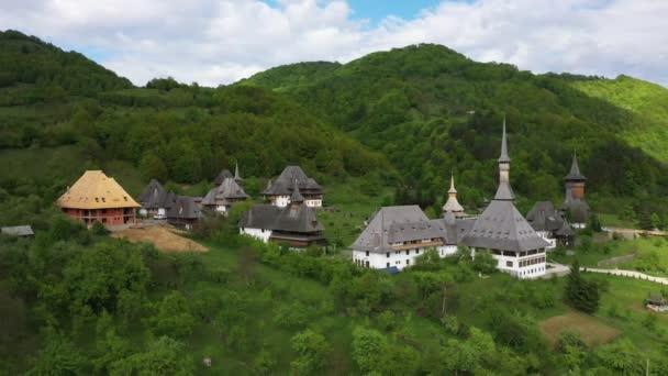 Aerial view over Barsana Monastery, Maramures - Romania. Wooden church UNESCO world heritage site