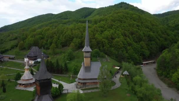 Aerial view over Barsana Monastery, Maramures - Romania. Wooden church UNESCO world heritage site