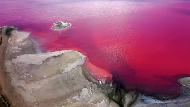 Aerial view of salt sea water evaporation ponds with pink plankton colour. Lake in pink