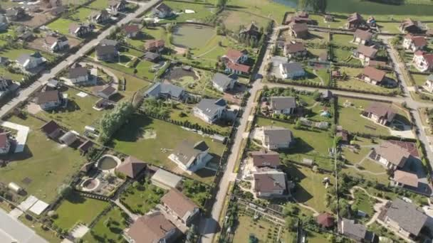 Aerial footage over a classica European housing estate, homes from above. Aerial shot over the top of housing estate. Aerial view over the village. Video without color correction 4K