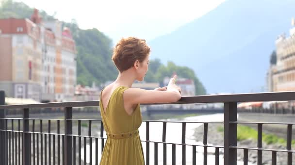 A beautiful woman uses a smartphone while traveling. Resort city, tourism, summer