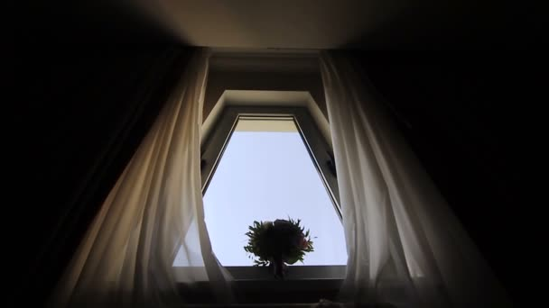 Wedding bouquet of white, pink and red flowers on the window. Brides morning.Bouquet near the window.