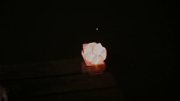 Lanterns on water at night